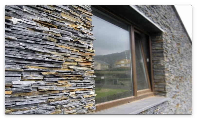 отделка дома из СИП панелей декоративным камнем